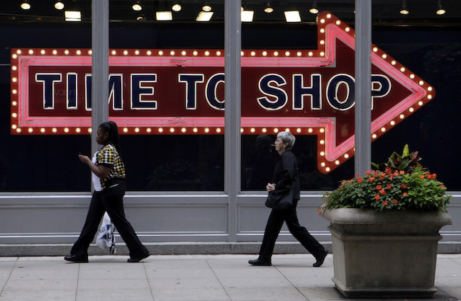 Pedestrians walk by the window display at an Old Navy store in Monday, Sept. 21, 2009 in downtown Chicago. (AP Photo/Kiichiro Sato)